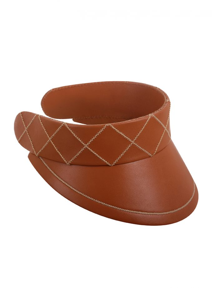 Limited edition hand-made tan leather visor with stitched detailing.