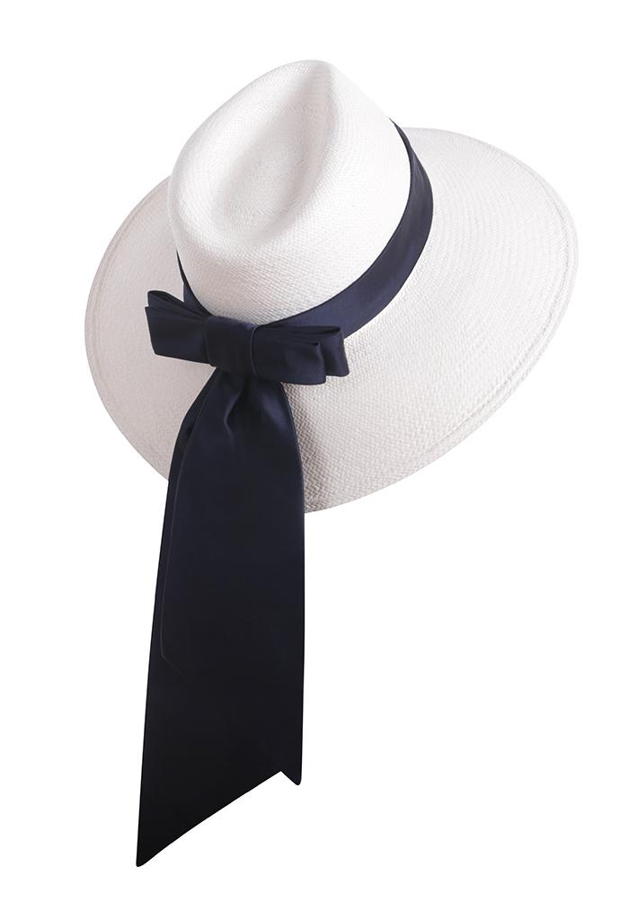 Wide brimmed panama straw hat with tailored navy silk bow