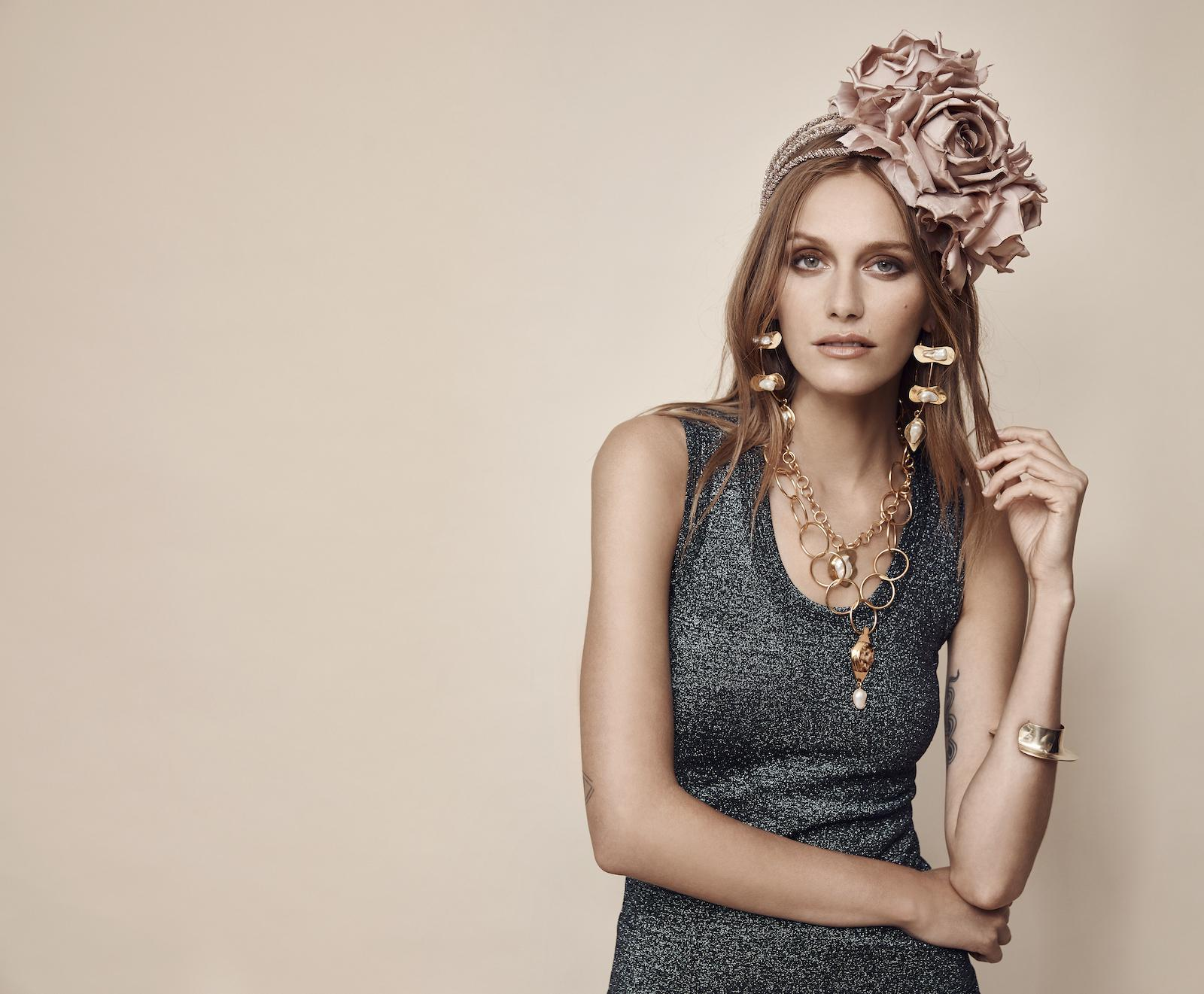 Blush pink floral headpiece on model